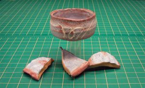 Rubber pottery bowl with blood fx shards